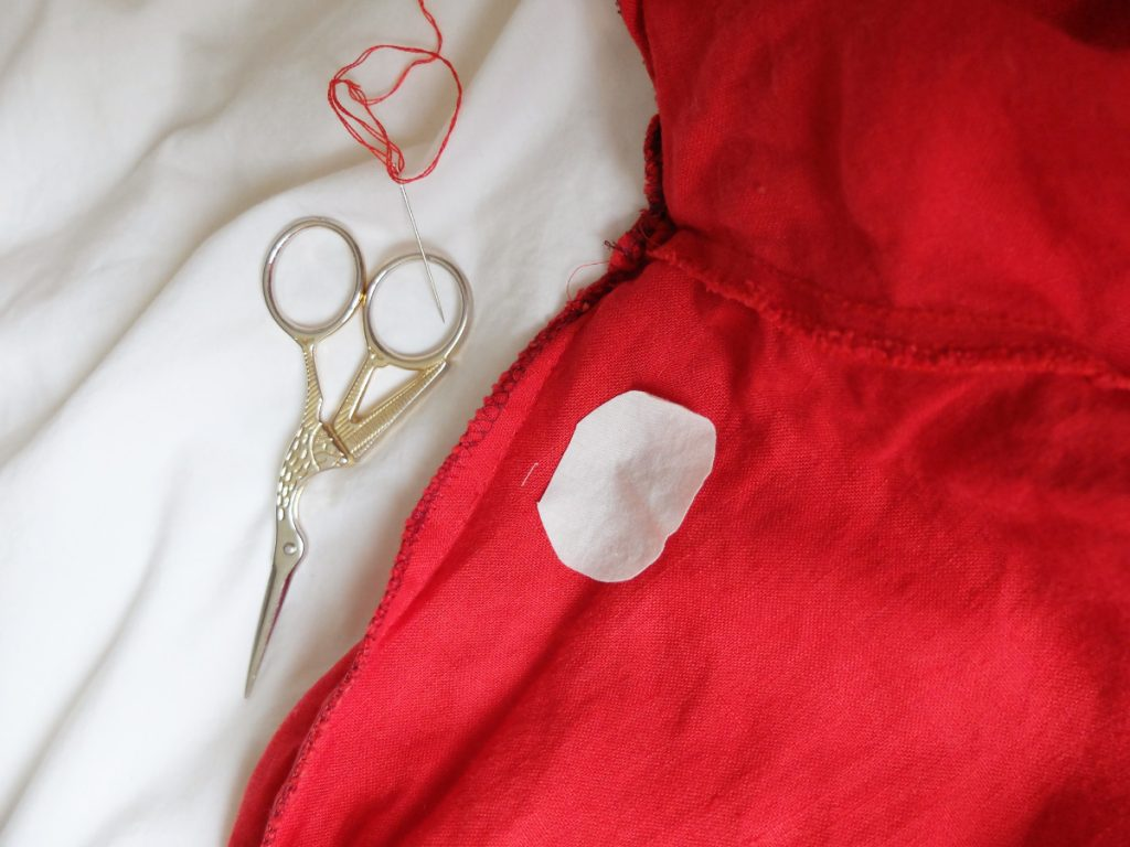 fix a hole : materials to mend pants: scissors needle, thread