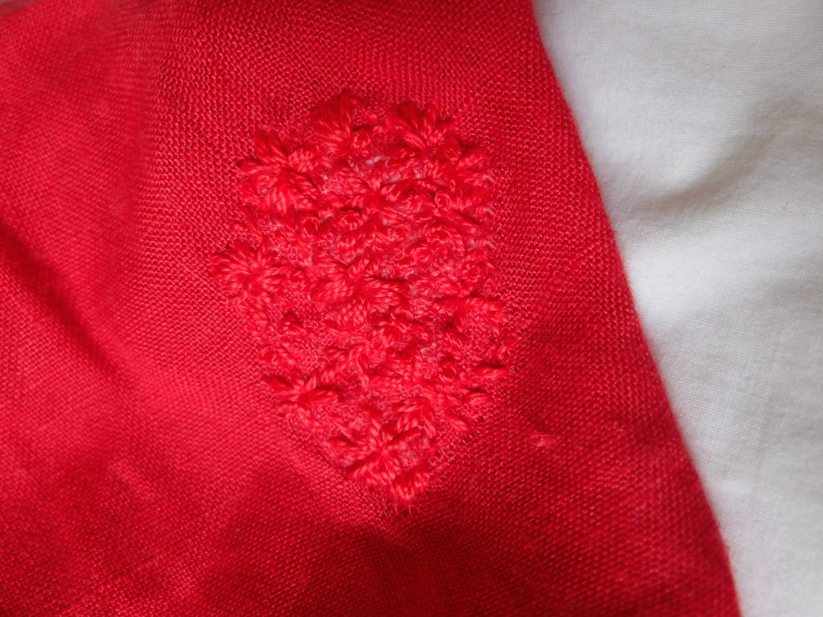 floral embroidery on red linen pants